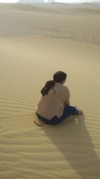Sandboarding sitting down