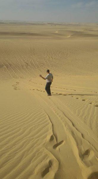 Sandboarding standing up