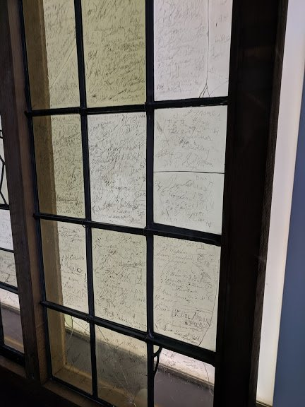 Fans of Shakespeare etched their signatures onto this original glass window